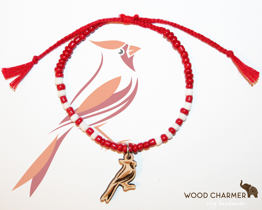 The Cardinal mascot engraved on a small wooden charm. Spirit Bracelet elementary school fundraiser