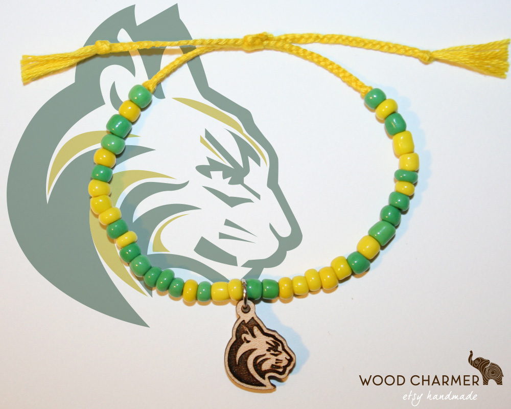 Wood Charmer customizes our charm bracelets with your team colors and your team mascot